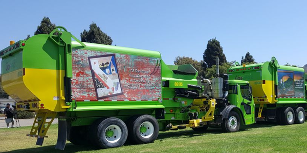 Four new refuse trucks display the artwork of residents who won the City of Lompoc's Mobile...