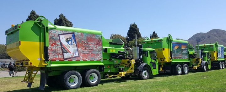 Four new refuse trucks display the artwork of residents who won the City of Lompoc's Mobile Mural Contest.  - Photo courtesy of City of Lompoc