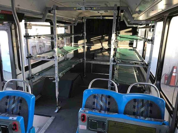 The vehicles are upfitted with cots, air conditioning, emergency lighting, and custom department decals.