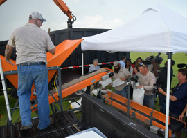 Manatee County, Fla., showed off its new sandbagging machines at a media event in June.