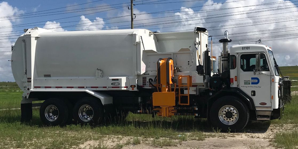 Miami-Dade County has already received 60 of the 77 refuse vehicles it ordered.