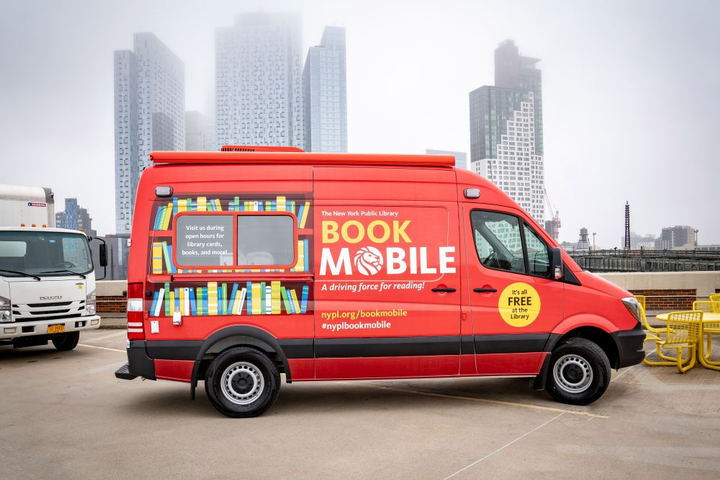 The new bookmobile is a Mercedes-Benz Sprinter van.