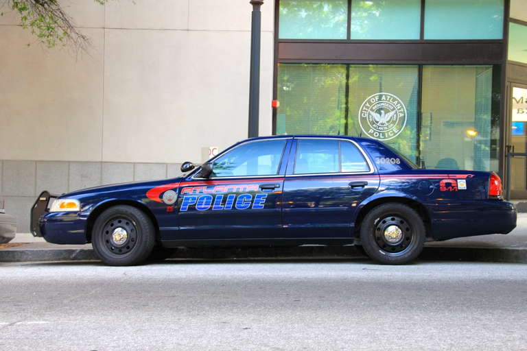 Atlanta's aged police fleet includes Ford Crown Victoria sedans.