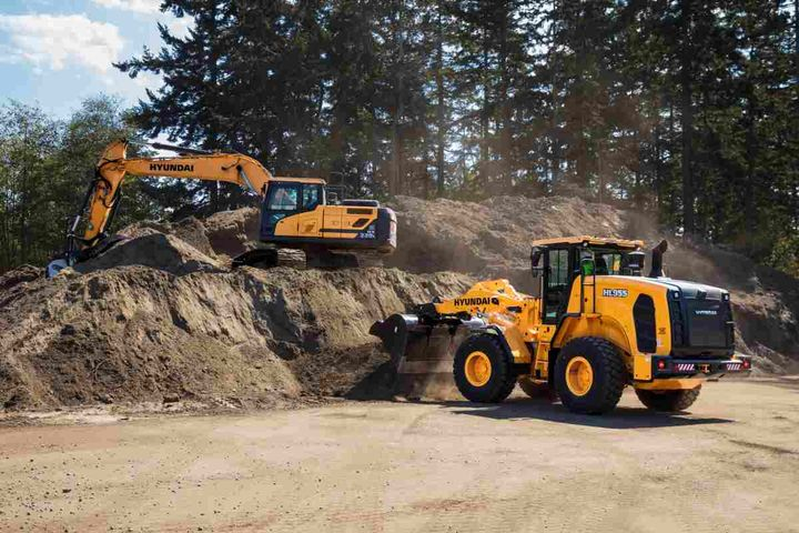 Pictured are Hyundai's HL955 and HX220L earthmoving equipment.