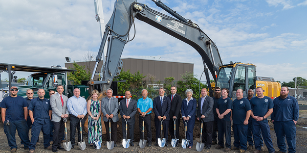 Monmouth County officials and staff pose at the groundbreaking for a new maintenance facility.
