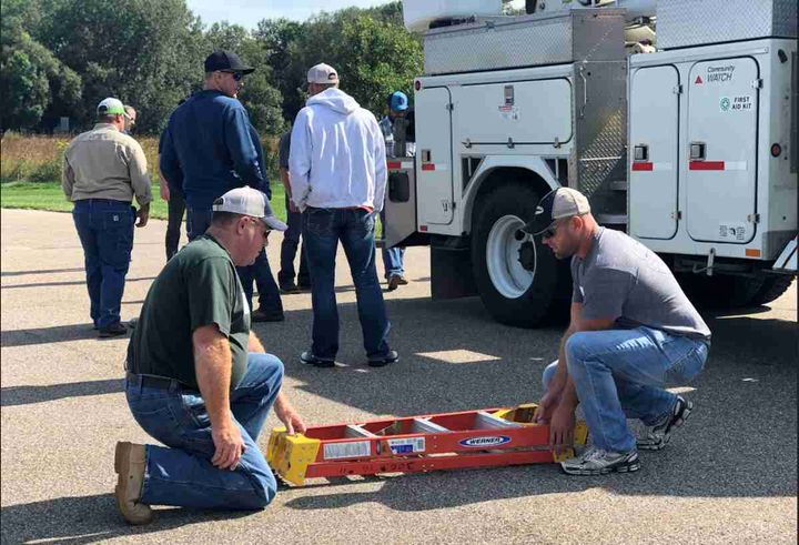 Electric utility employees receive training on correct movements to reduce injuries.