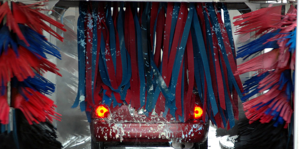 The vehicle wash is large enough to accommodate a bus or large plow truck.