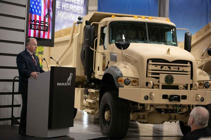 Mack Defense President David Hartzell (top left) officially presented the first five Mack Granite-based M917A3 heavy dump trucks (top right) to the U.S. Army during a ceremony at the Mack Customer Center.
