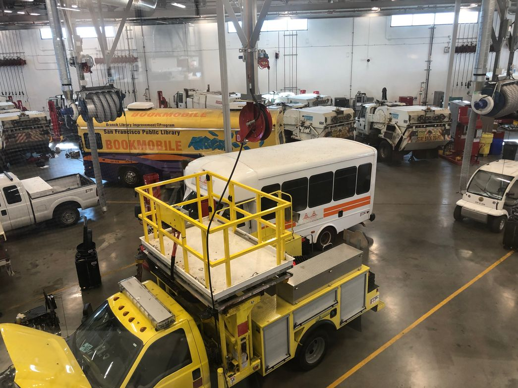 In the heavy shop, vehicle lifts are strategically placed. Many stalls are left without lifts,...