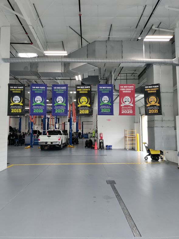 The main entrance includes banners of awards won by the fleet team.