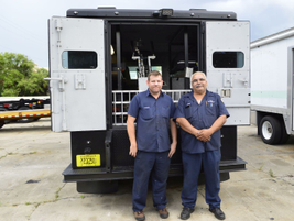 Tim Hahn (left) and Ernie Reina refurbished and upfitted this Tampa Police Department bomb...