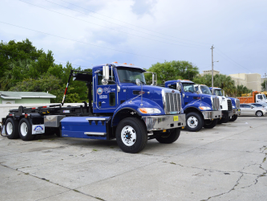 Five heavy-duty trucks for the Solid Waste Department are waiting to be put in service.