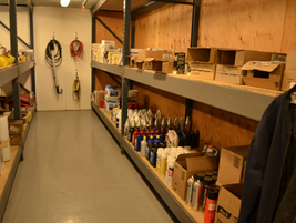 The fleet carries about $7,500 in parts inventory, stored in the pictured parts room.