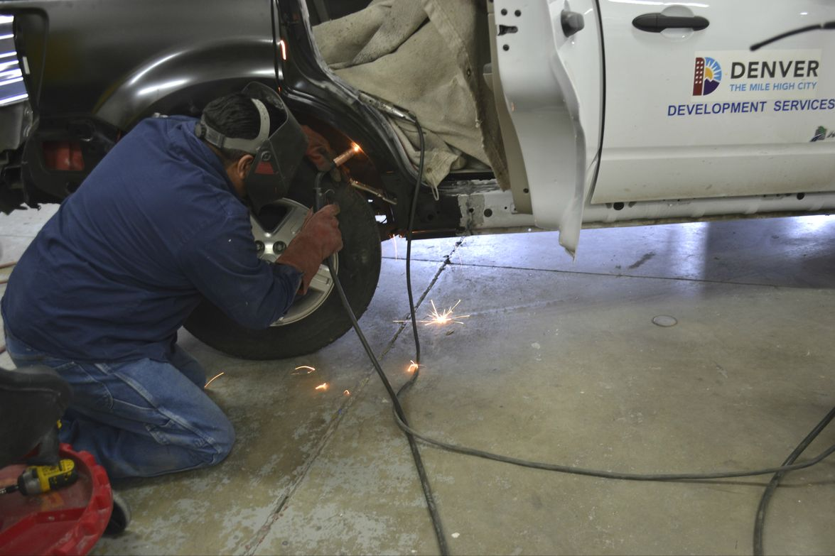 Desi Apodaca, the fleet's welder, is pictured at work on a vehicle.