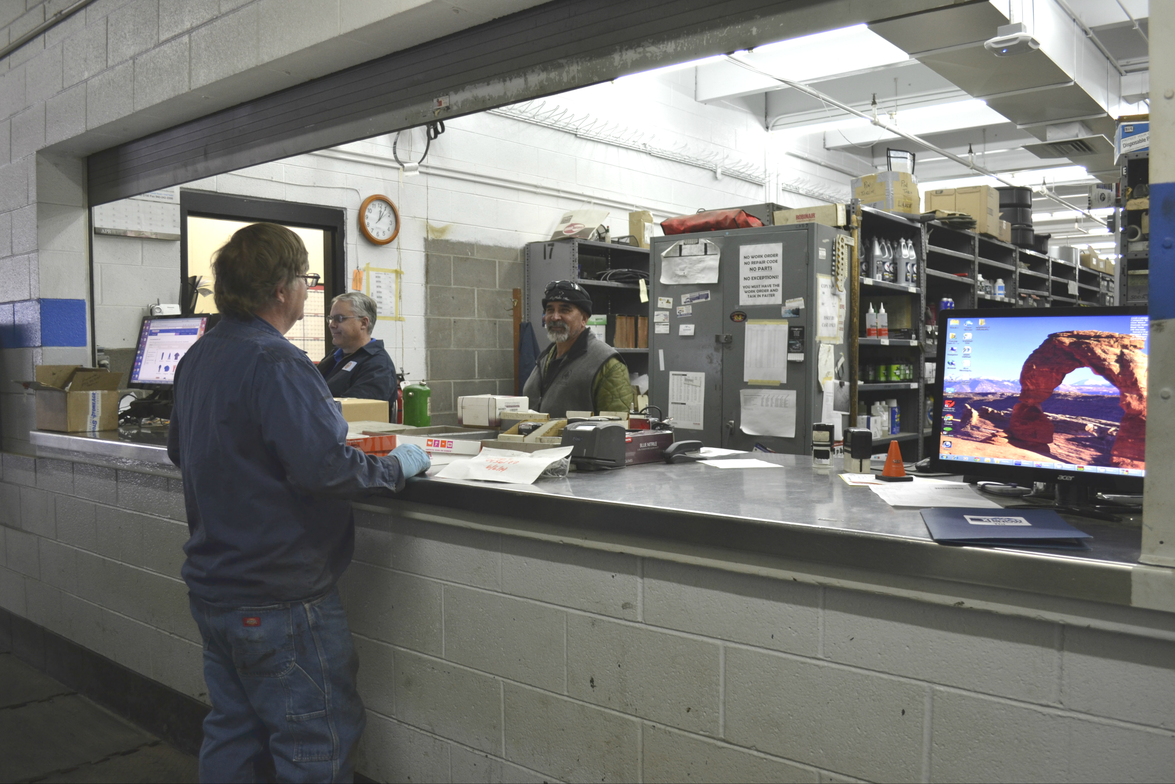 Tommy Phillips is pictured interacting with parts room staff members (l-r) Michael Brosh and...