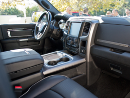 The premium interior includes an Alpine headunit, leather surfaces, and real lacquered wood.