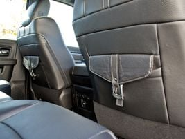 The front seats include briefcase-style pockets.