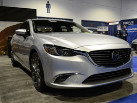The 2017 Mazda 6 Touring sedan features the SkyActive-G 2.5L 4-cylinder engine with variable...