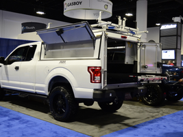 A.R.E. featured a new heavy-duty aluminum commercial cab DCU, pictured here on the Ford F-150.