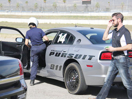 A female LAPD vehicle evaluator gets behind the wheel of the AWD V-8 Dodge Charger Pursuit.