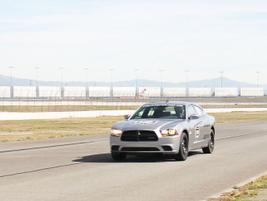 A Dodge Charger Pursuit races toward the finish line.