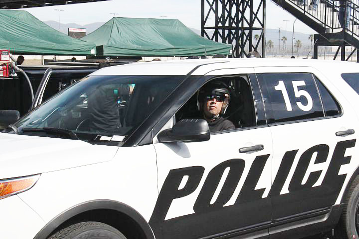 A LASD deputy rolls the Ford P.I. Utility EcoBoost toward the road course for testing.