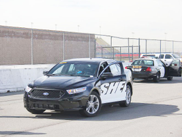 Ford personnel ready a Police Interceptor sedan for testing.