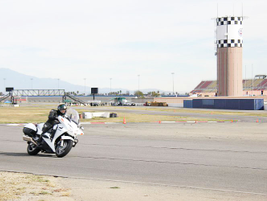 The Honda ST1300 accelerates into a straightaway.