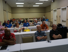 Attendees are pictured at an educational session.Photo by Mark Kostos