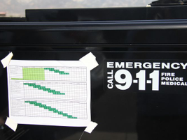 A schedule taped to a sheriff's vehicle shows the order of vehicles tested.