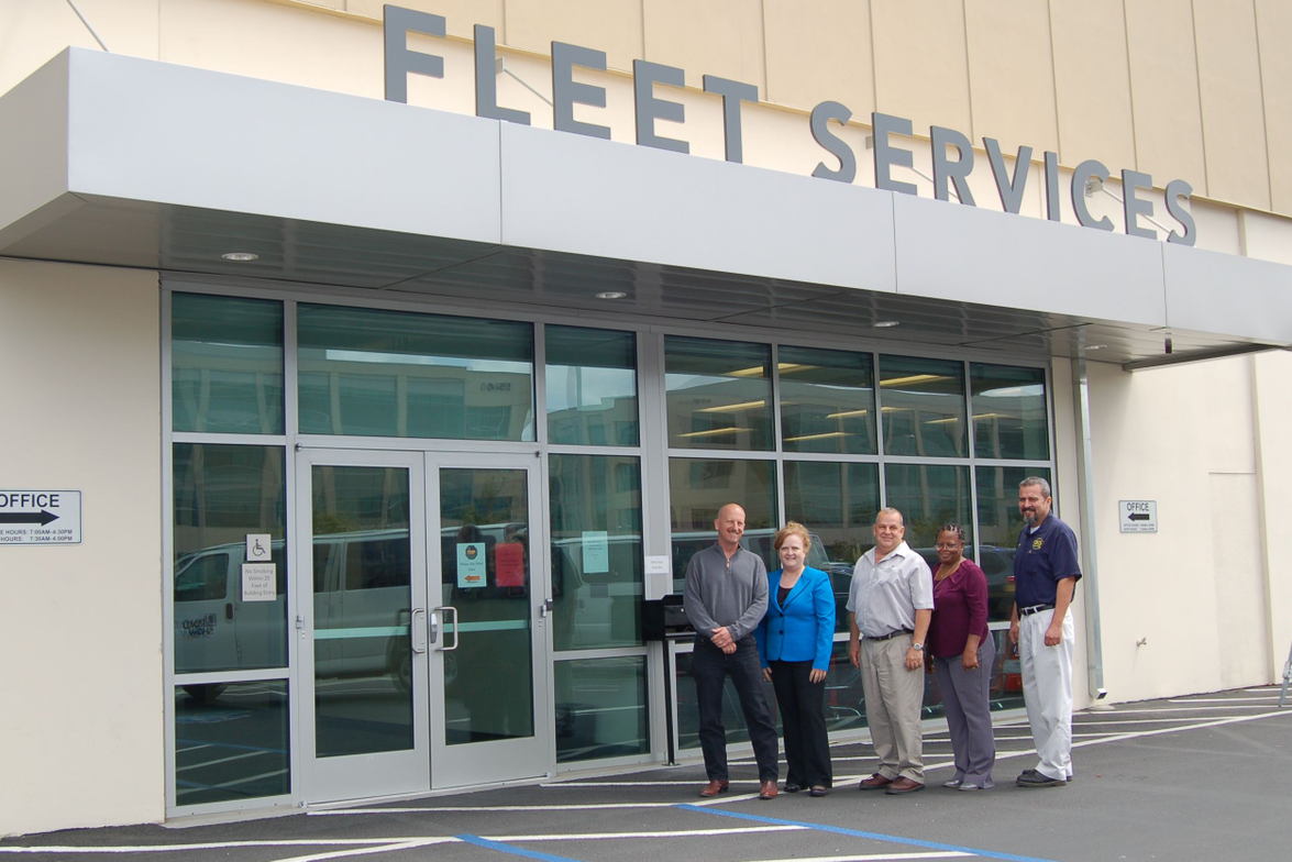 Pictured left to right are: Don Holland, fleet coordinator; Sharyl Blackington, fleet manager;...