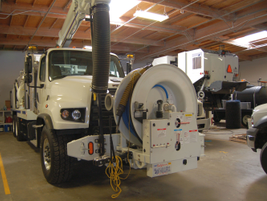 This Vaccon sewer truck, a fan unit,  holds 1,100 gallons of water and has an 11-yard debris...
