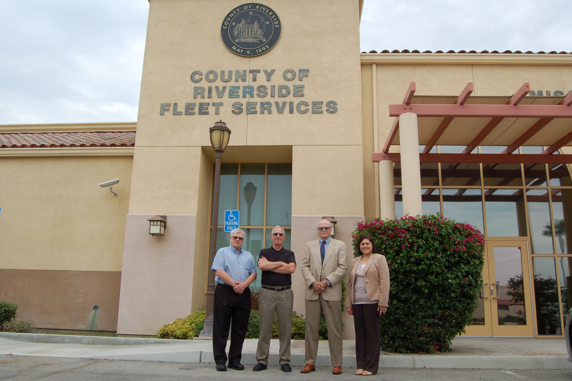 Pictured left to right are Doug Baracz, deputy director of fleet and purchasing; Ted Trujillo,...