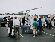 Block Party attendees check out a solar-powered electric vehicle charger from Envision Solar.