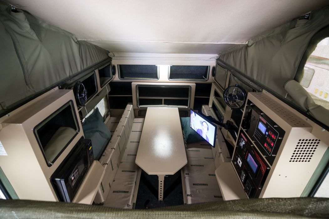 The vehicle is built for versatility, and center can be used as a bed or a resting area.