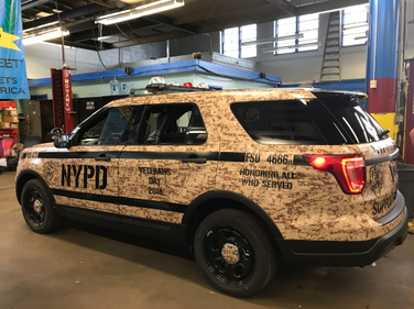 The Veterans Day police car is used during November.