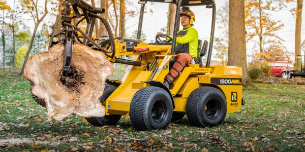 With a standard mini skid steer attachment plate, the Rayco 1800AWL articulated wheel loader can...