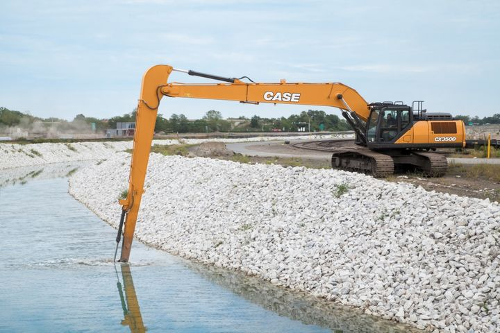 D Series excavators achieve faster cycle times through a new electronically controlled pump, a larger control valve, and multiple advanced sensors.  - Photo courtesy of Case