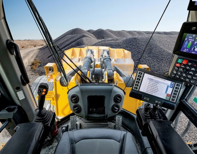The system is integrated with JDLink telematics, allowing users to track and visualize payload data. - Photo courtesy of John Deere
