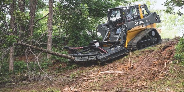 The rotary cutter attachments are compatible on large-frame skid steer and compact track loaders.