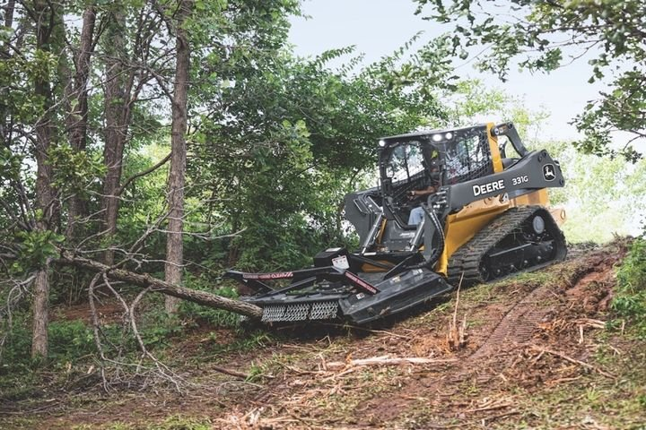 The rotary cutter attachments are compatible on large-frame skid steer and compact track loaders. - Photo courtesy of John Deere