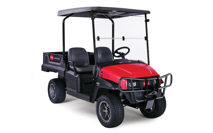 The higher clearance of the Workman GTX Utility Vehicles protects golf courses by making it easier for operators to drive over rough or uneven areas without causing damage. - Photo courtesy of Toro