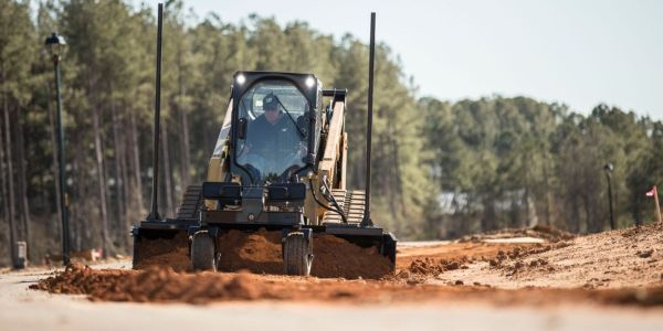 Pictured is the Cat compact track loader with Grader Blade Smart attachment.
