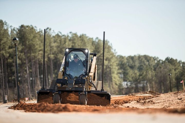 Pictured is the Cat compact track loader with Grader Blade Smart attachment. - Photo: Caterpillar