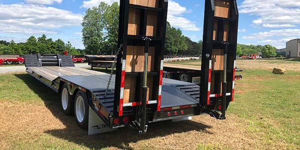 The 35-ton trailer is rated at 70,000 pounds concentrated in 20 feet and features hydraulic...