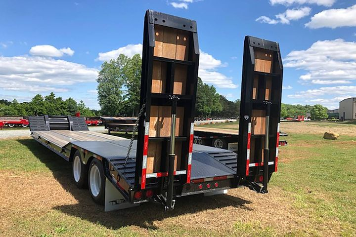The 35-ton trailer is rated at 70,000 pounds concentrated in 20 feet and features hydraulic ramps for safe, efficient loading and unloading in confined spaces. - Photo:Talbert Manufacturing