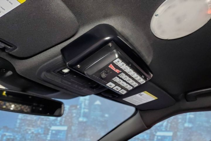 The new overhead console mounts a remote light and siren control head in the OEM overhead console area. - Photo: Havis