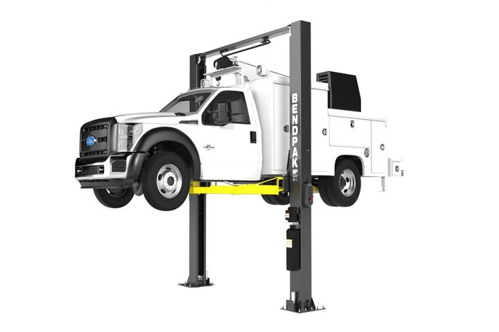BendPak's new XPR-12C-LTA two-post truck lift has a rated capacity of 12,000 pounds and three-stage telescoping front and rear arms that help technicians reach challenging lifting points on trucks and other vehicles with long wheelbases. - Photo: Bendpak