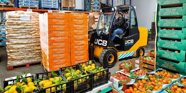 The JCB's 66-40E Electric Teletruk's 6,600-lb. maximum lift capacity allows for heavy lifting...