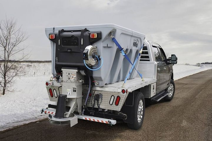 Every IceStriker spreader features liquid tanks integrated into both sides of the double-walled poly hopper, which hold up to 220 gallons of liquid. - Photo: Hilltip